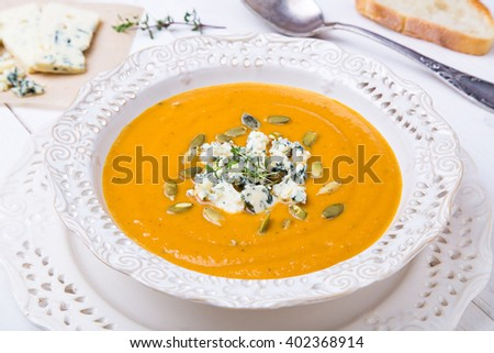Squash Soup with Blue Cheese and Thyme - stock photo