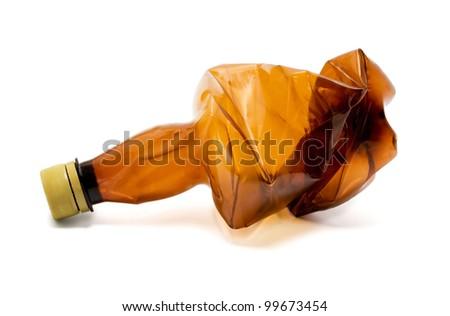 Squashed plastic bottle isolated on white background - stock photo