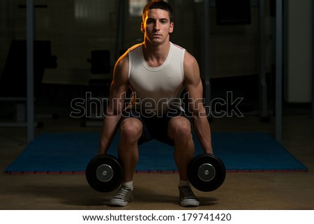 Squats With Dumbbells - stock photo