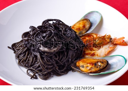 Squid Ink Pasta With Shrimp and mussel - stock photo