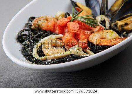 Squid Ink Spaghetti with Tomatoes, Calamari, Shrimps and Mussels