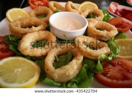 Squid ring with sauce on the dinner plate. - stock photo