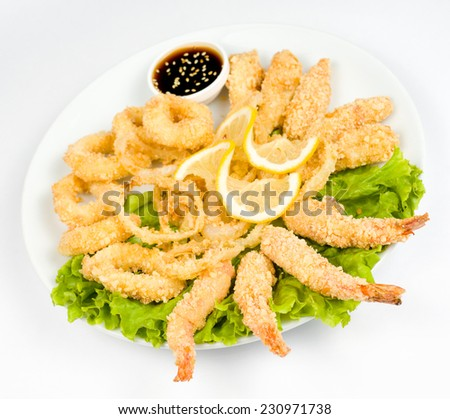 squid rings, shrimps and cheese sticks, fried in batter - stock photo