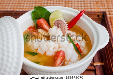 squid spicy lemongrass soup, tom yum - stock photo