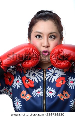 squint eyed crazy woman in boxing gloves isolated on white - stock photo