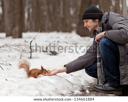 Squirrel and boy with nuts.
