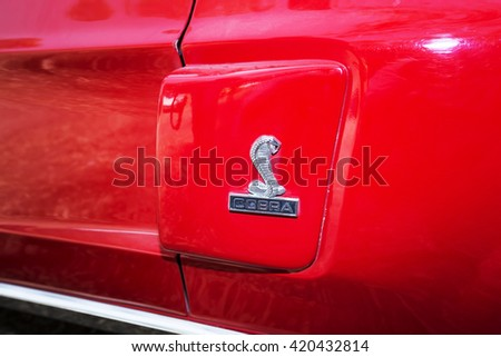 SRAEL, PETAH TIQWA - MAY 14, 2016:  Ford Mustang  Cobra Sign Close Up in Israel. Exhibition of technical antiques on May 14, 2016 in Petah Tiqwa, Israel - stock photo