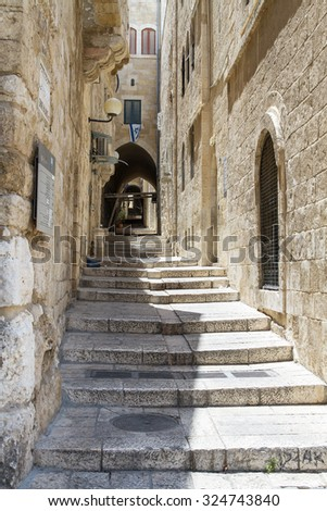 Sreet of Jerusalem Old City Alley made with hand curved stones. Israel - stock photo