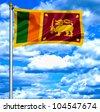 Sri Lanka waving flag against blue sky - stock photo