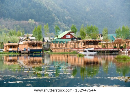 SRINAGAR, INDIA - April 13: Houseboats, the floating luxury hotels in Dal Lake on April 13, 2012 in Srinagar, Kashmir, India