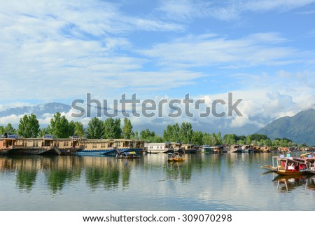 SRINAGAR, INDIA - JUL 21, 2015. Lifestyle in Dal lake, many small boats for transportation in the lake of Srinagar, Jammu and Kashmir state, India.