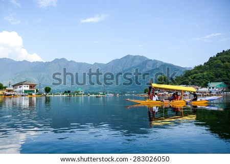 SRINAGAR, INDIA - JULY 11, 2014 : Lifestyle in Dal lake, local people use 'Shikara', a small boat for transportation in the lake of Srinagar, Jammu and Kashmir state, India