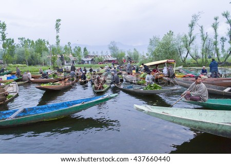 SRINAGAR KASHMIR - CIRCA APRIL 2016 - Unidentified vegetable sellers taking their produce to the Dal Lake early morning floating market.