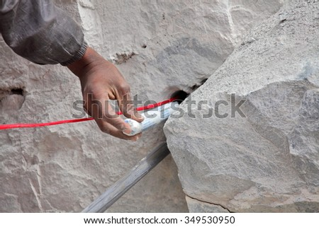 SRINAGAR â?? LEH ROAD, INDIA - JUNE 11, 2015:  Preparation for explosive works on construction of Srinagar â?? Leh road in the Himalayas in Jammu & Kashmir, India.  - stock photo
