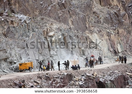 SRINAGAR, LEH ROAD, INDIA - JUNE 11, 2015: Preparation for explosive works on construction of Srinagar  Leh road in the Himalayas in Jammu & Kashmir, India - stock photo