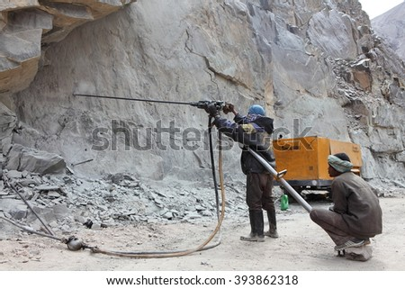 SRINAGAR  LEH ROAD, INDIA - JUNE 11, 2015: Preparation for explosive works on construction of Srinagar Leh road in the Himalayas in Jammu & Kashmir, India - stock photo