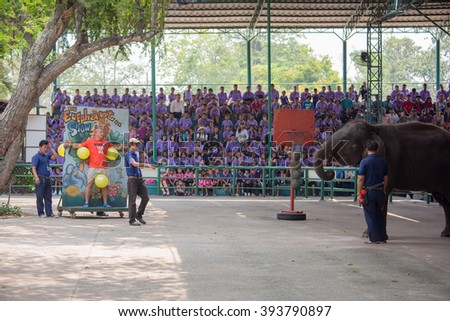 SRIRACHA, THAILAND - MAR 18 : Daily elephant show - elephants throwing darts to male tourist at Sriracha Tiger Zoo. March 18 ,2016 Sriracha Chonburi Province, Thailand.
