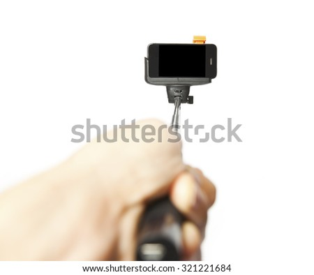 Srlfie stick with phone in man's hand on white background