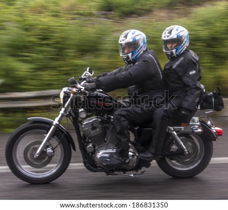 SSICILY, ITALY - APRIL 6, 2014: Members of H.O.G. Malta Chapter on their Harley-Davidson motorcycles in Sicily. Harley Owners Group (H.O.G.) is made up of various local chapters from around the world. - stock photo