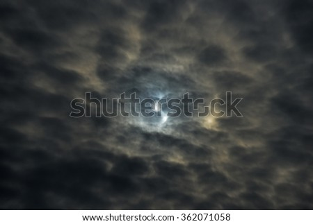 SSun behind breaking clouds - stock photo