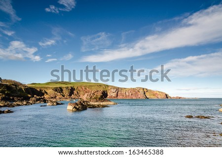 St Abbs cliffs / A rugged and rocky approach to St Abbs harbour - stock photo