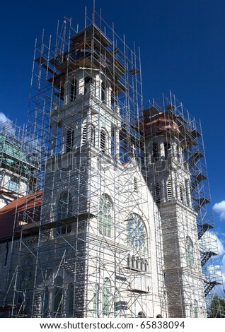 St Adalbert��s Catholic Church: Repair work is being done with new cooper shingles on the top of the basilica of St Adalbert�s Church in Grand Rapids Michigan. - stock photo