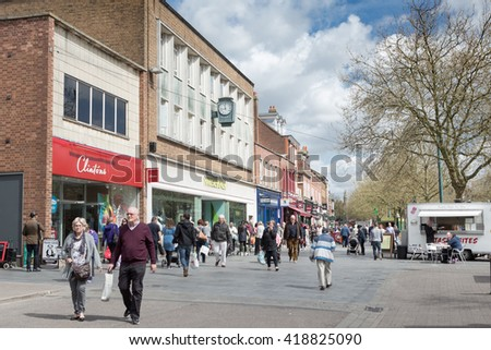 ST ALBANS, UK - MAY 3, 2016: Shoppers enjoy warm Spring weather on St Peters Street