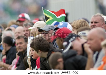 ST ANDREWS, SCOTLAND. July 18 2010: A south African flag flying in the specator area during the final round of The Open Championship   played on The Royal and Ancient Old Course.  - stock photo