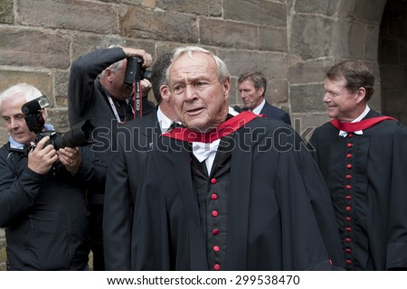 ST ANDREWS, SCOTLAND. July 13 2010: Arnold Palmer and Tom Watson during the parade to the university in order for the honorary awards to Padraig HARRINGTON Tom Watson, and Arnold Palmer - stock photo