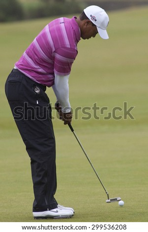 ST ANDREWS, SCOTLAND. July 15 2010: Tiger WOODS from the USA in action on the first day of The Open Championship   played on The Royal and Ancient Old Course - stock photo