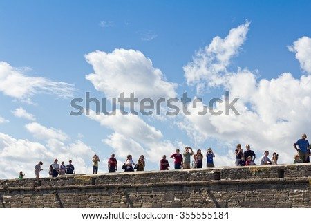 ST. AUGUSTINE, FLORIDA - NOVEMBER 21: Tourists on the fort wall at Castillo de San Marcos on November 21, 2010 in St. Augustine, Florida, USA. - stock photo