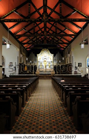 St Augustine, Florida, USA - 20 March 2017: Cathedral Basilica of St. Augustine interior, truss ceiling of the eclectic structure, a mix between Spanish Mission and Neoclassical architecture styles.