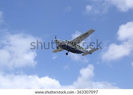 ST. BARTS, FRENCH WEST INDIES - JUNE 12, 2015: St. Barth Commuter plane taking off from St Barts airport. St. Barts is considered a playground of the rich and famous.