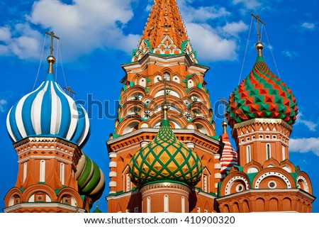 St. Basil's Cathedral on Red square in Moscow, Russia. Domes of cathedral against blue sky. Close up view of Moscow St. Basil's Cathedral - stock photo