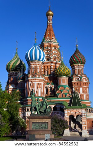 St. Basil's Cathedral (Pokrovsky Cathedral), and the monument to Minin and Pozharsky in Moscow. - stock photo