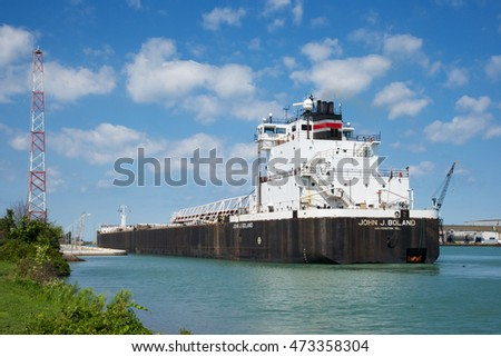 St. Catharines, Ontario, Canada - August 23, 2016: The John J. Boland Self Discharging Bulk Carrier preparing to enter Lock 1 while navigating north on the Welland Canal