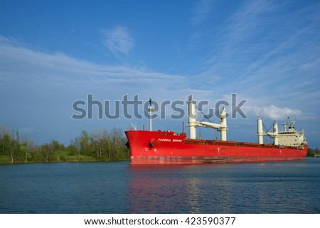 St. Catharines, Ontario, Canada - May 16, 2016: The Federal Bering Bulk Carrier navigating north along the Welland Canal