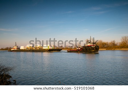 St. Catharines, Ontario, Canada - November 15, 2016: The Ecosse and Sea Crescent Tugs transporting a barge south up the Welland Canal
