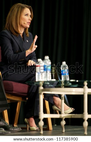ST. CLOUD, UNITED STATES - OCTOBER 30: Republican U.S. Rep. Michele Bachmann speaks to voters during a debate against Democrat challenger Jim Graves on October 30, 2012 in St. Cloud. - stock photo