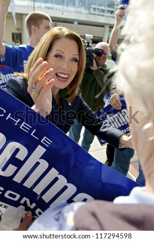 ST. CLOUD, UNITED STATES - OCTOBER 30: U.S. Rep. Michele Bachmann greets an elderly supporter before a debate against Democrat Jim Graves on October 30, 2012 in St. Cloud. - stock photo