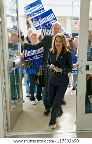 ST. CLOUD, UNITED STATES - OCTOBER 30: U.S. Rep. Michelle Bachmann enters the St. Cloud Convention Center for her debate against Democrat challenger Jim Graves on October 30, 2012 in St. Cloud. - stock photo