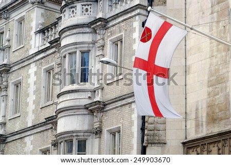 St. George flag on a pylon in City of London, United Kingdom - stock photo