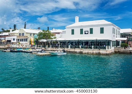 ST.GEORGEâ??S, BERMUDA, MAY 27 - Turquoise colored water surrounds this restaurant with outdoor dining on May 27 2016 in St. Georges Bermuda. - stock photo