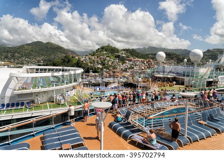 ST. GEORGE'S, GRENADA - FEBRUARY 2, 2015: Two large cruise ships full of tourists dock in Grenada who is a very popular destination in winter.