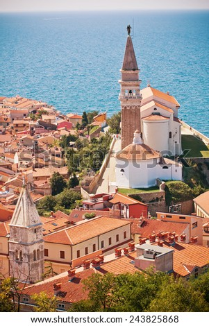 St. George's Parish Church with sea in background - stock photo