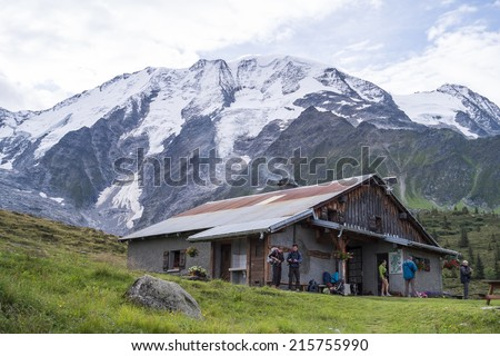 ST-GERVAIS-LES-BAINS, FRANCE - AUGUST 25: Hikers at the Truc Hostel, at bottom of the Domes de Miage mountain. This is one of the stages of the Mont Blanc Tour August 25, 2014 in St-Gervais-les-Bains. - stock photo