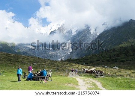 ST-GERVAIS-LES-BAINS, FRANCE - AUGUST 24: Hikers at the Truc Hostel, at bottom of the Domes de Miage mountain. This is one of the stages of the Mont Blanc Tour August 24, 2014 in St-Gervais-les-Bains. - stock photo