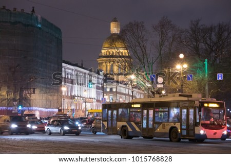 St. Isaac's Cathedral and evening traffic in St. Petersburg .Russia, St. Petersburg, Dvortsovaya Square, January 19, 2018. EDITORIAL