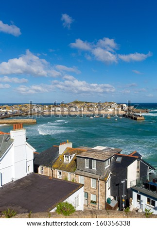 St Ives Cornwall England with harbour, boats and blue sea and sky, a traditional Cornish and English fishing town in the UK - stock photo