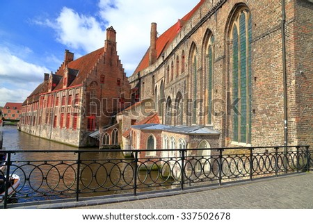 St John's hospital with Gothic architecture near a canal in Bruges, Belgium